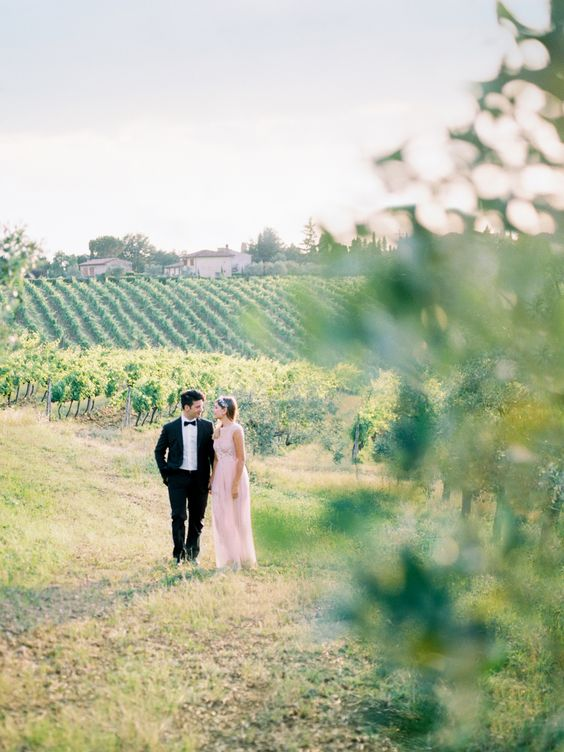 couple-walking-through-vineyard-in-tuscany