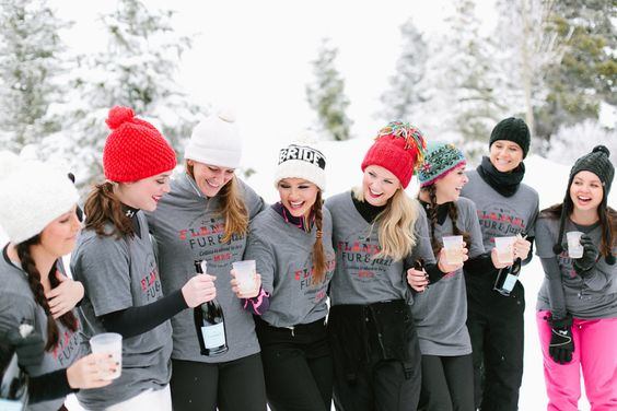 bridesmaids-in-the-snow-sipping-champagne-in-matching-shirts