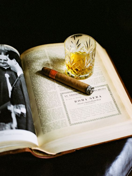 cigar-whiskey-on-book