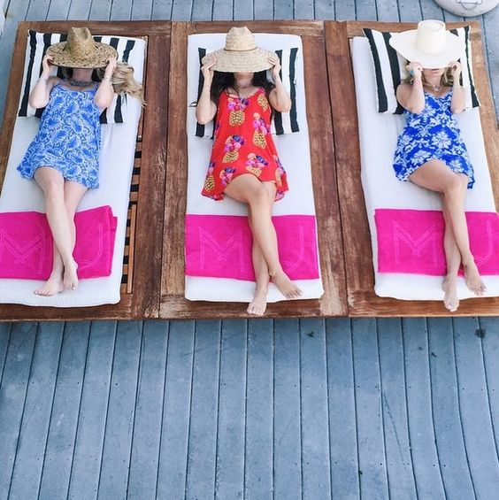 girls-laying-out-in-print-dresses-and-sunhats