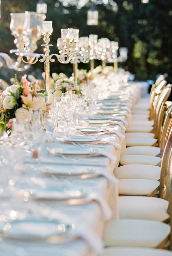 beautiful-wedding-kings-tables-with-candles-and-low-flowers