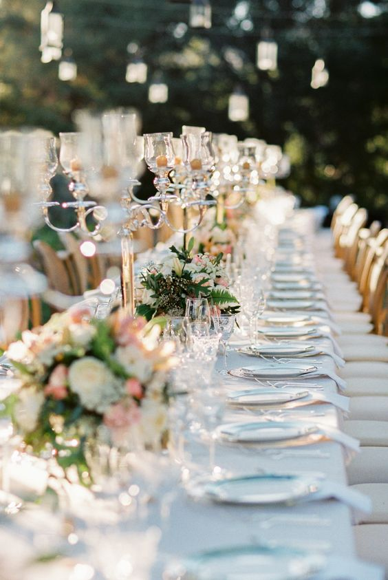 gorgeous-outdoor-wedding-kings-table-with-candles-light-blue-linens