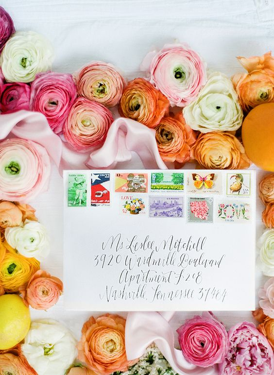 wedding invitation against ombre flowers