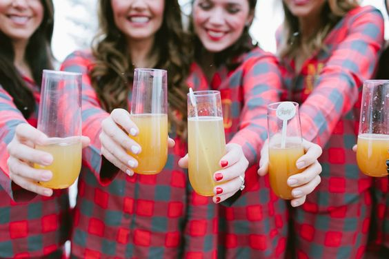 girls-in-flannel-pjs-sipping-mimosas
