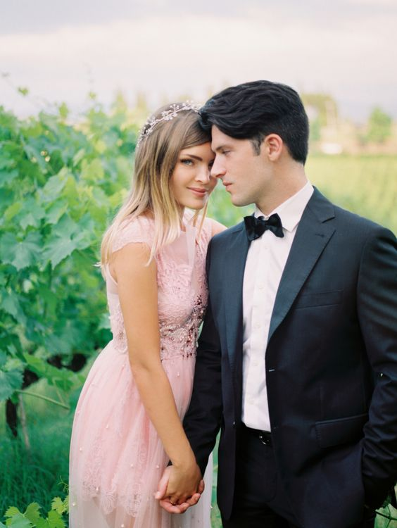 girl-long-pink-dress-in-styled-shoot-with-groom-in-black-tux