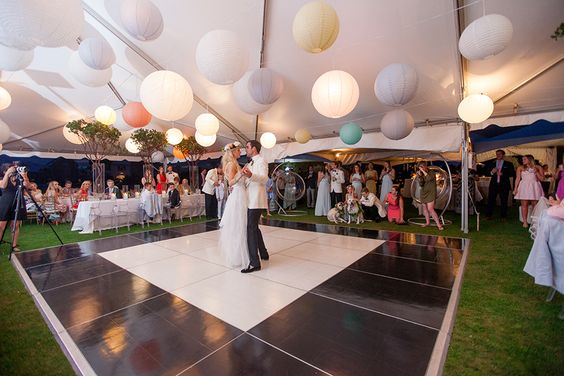 bride-and-groom-dancing-under-marquee-tent-and-balloons