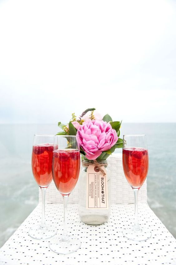 rose champagne, pink peonies next to ocean