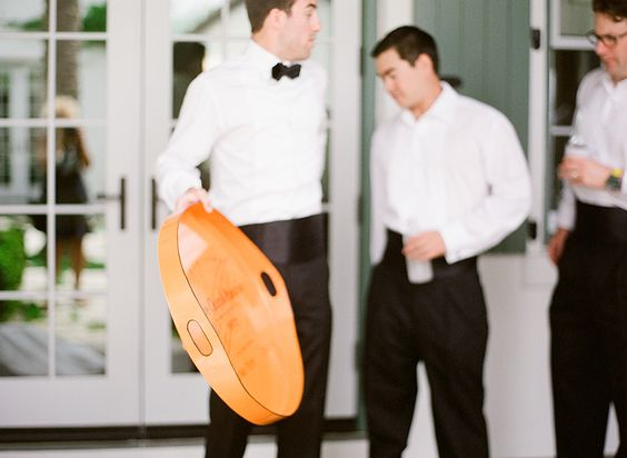 groom holding custom drink tray from bride