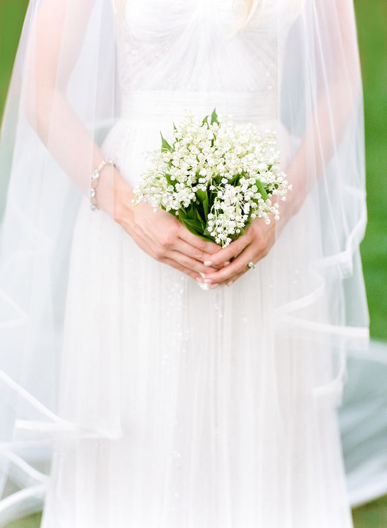 bride holding baby's breath bridal bouquet