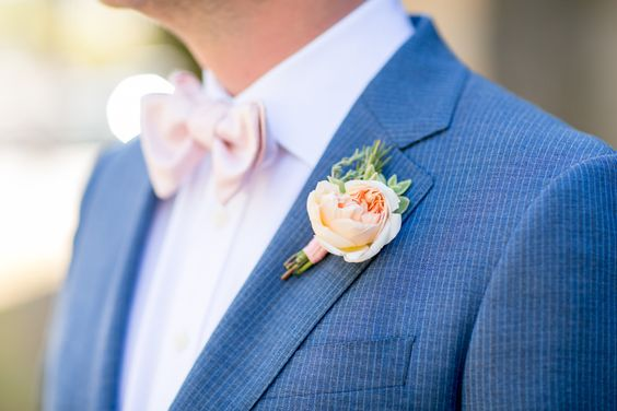 groom-in-blue-suit-pink-bow-tie-and-peach-boutineer