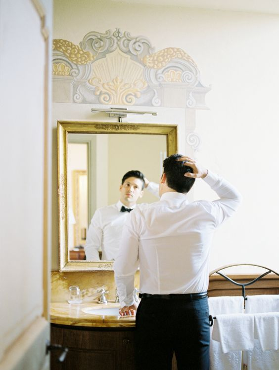 groom-getting-ready-for-photo-shoot