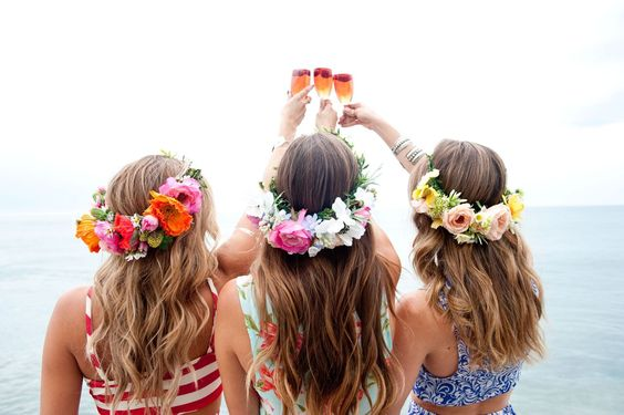 bridesmaids-holding-mimosas-at-beach-house-bachelorette-party