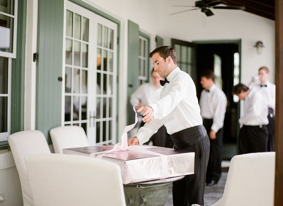 groom opening gift from bride
