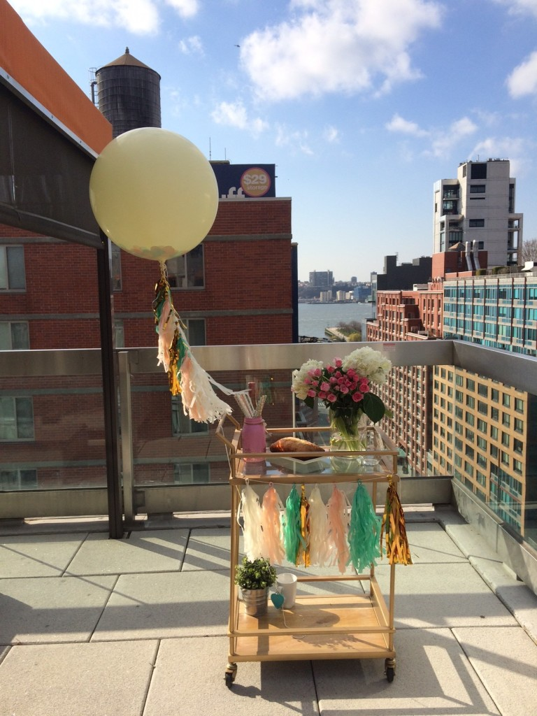 styled gold bar cart on nyc rooftop