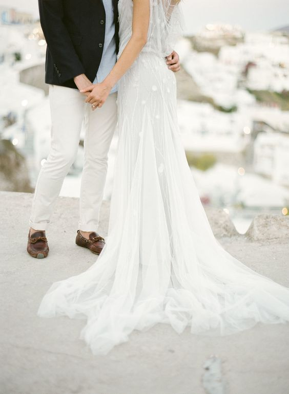 white-sheer-dress-santorini-backdrop http://itgirlweddings.com/santorini-honeymoon-inspiration/