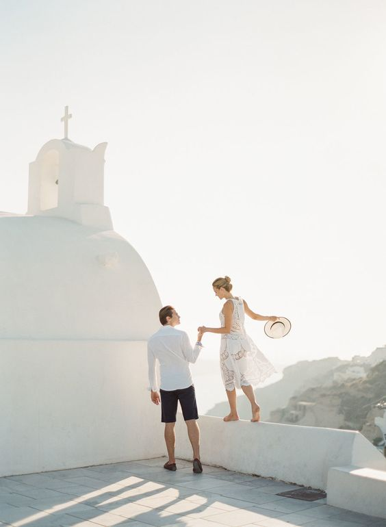 couple-in-santorini-on-honeymoon http://itgirlweddings.com/santorini-honeymoon-inspiration/