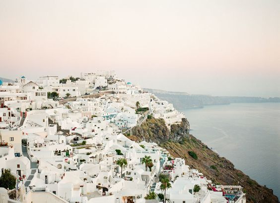 santorini-coastline-view http://itgirlweddings.com/santorini-honeymoon-inspiration/