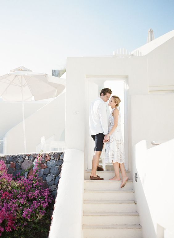 couple-in-white-attire-in-santorini http://itgirlweddings.com/santorini-honeymoon-inspiration/
