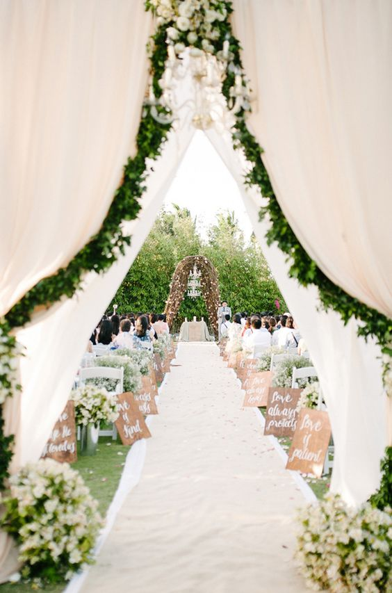 signs-down-the-aisle-curtains-chandelier http://itgirlweddings.com/write-wedding-vows/