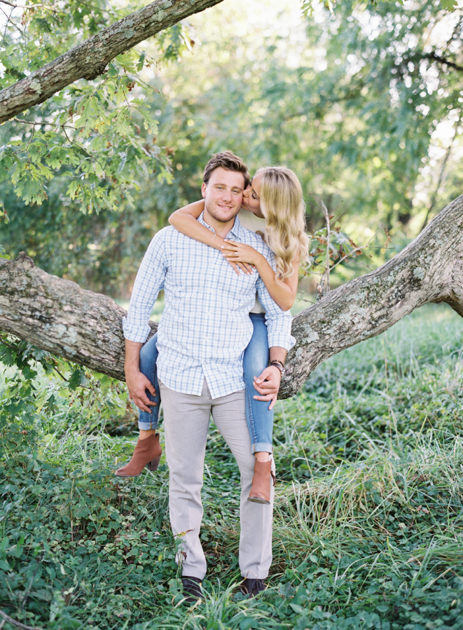 bride-groom-on-a-tree-engagement-shoot http://itgirlweddings.com/plantation-engagement-session/