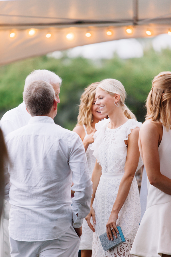 bride-in-white-rehearsal-dinner-dress http://itgirlweddings.com/white-party-rehearsal-dinner/