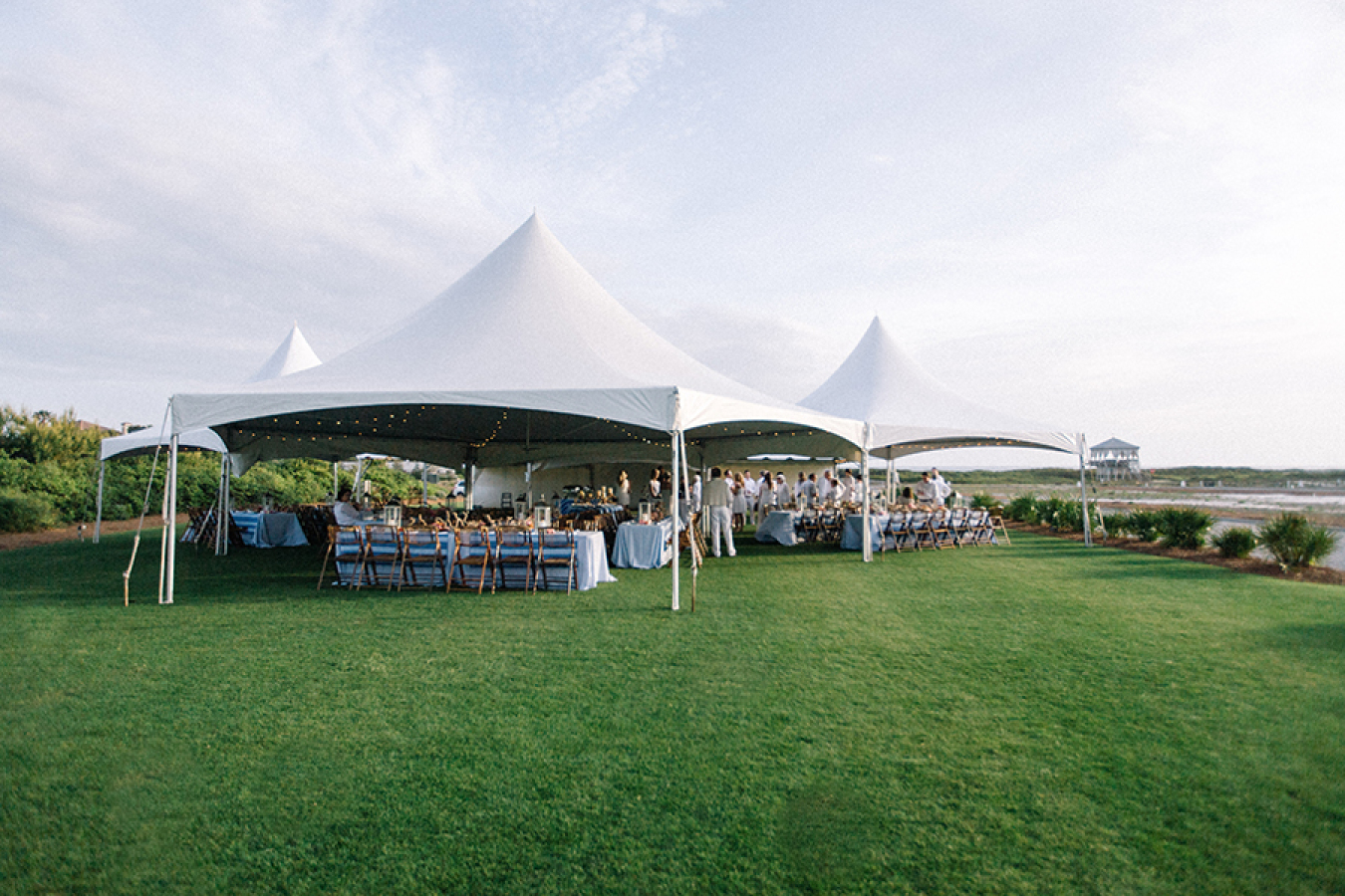 rehearsal-dinner-under-marquee-tent http://itgirlweddings.com/white-party-rehearsal-dinner/