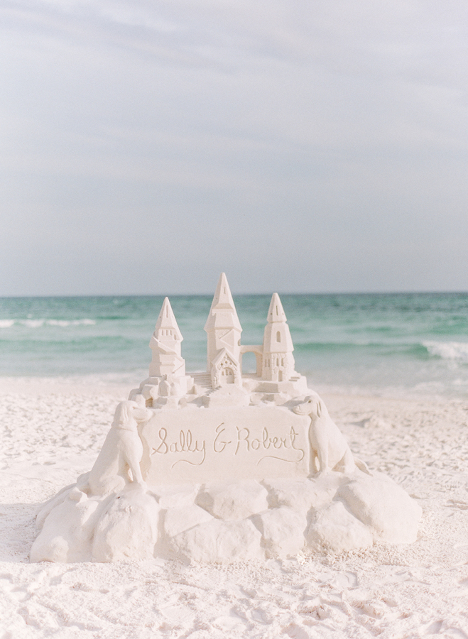 custom-sand-sculpture http://itgirlweddings.com/white-party-rehearsal-dinner/
