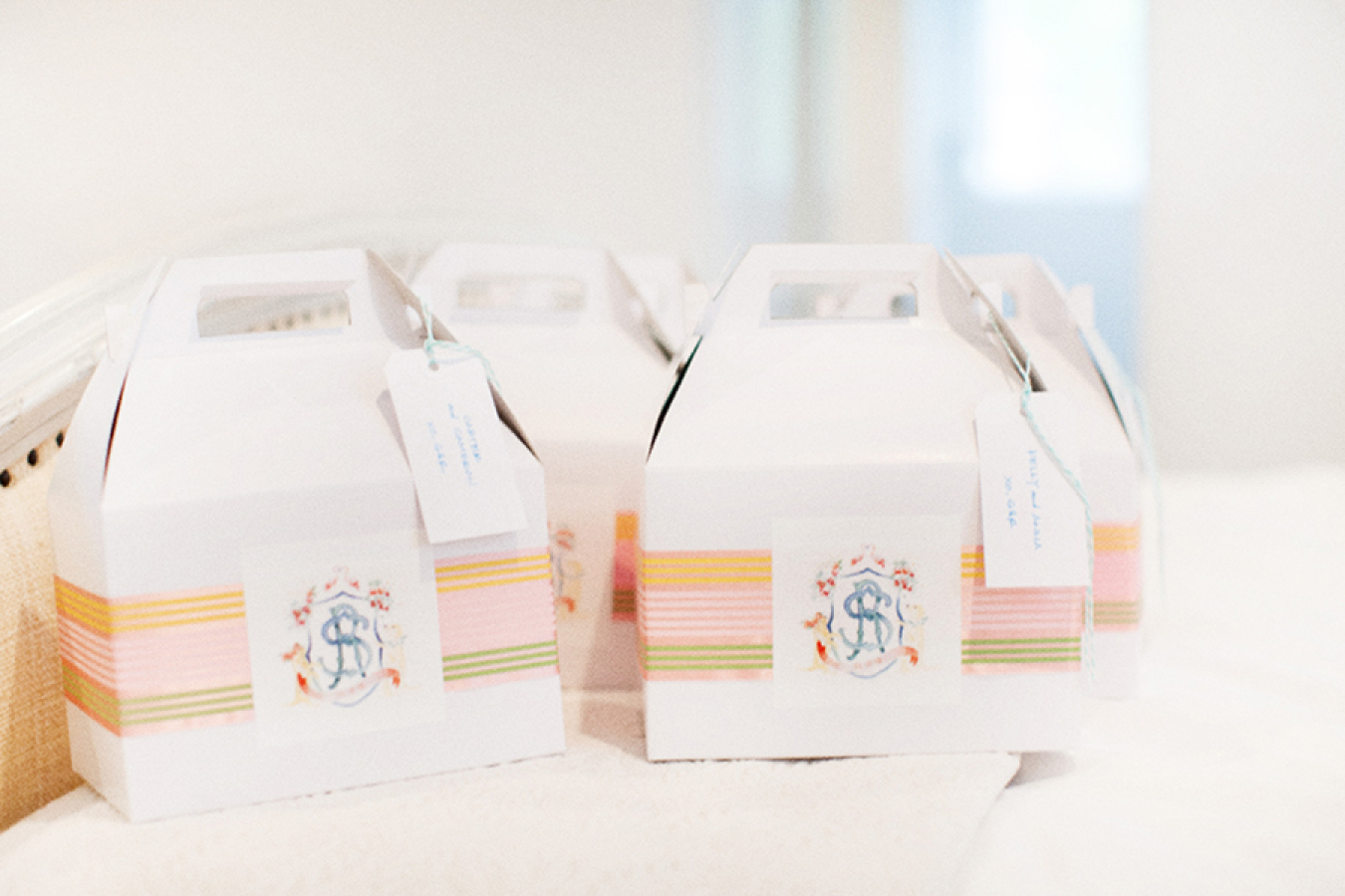 custom-rehearsal-dinner-gift-boxes http://itgirlweddings.com/white-party-rehearsal-dinner/