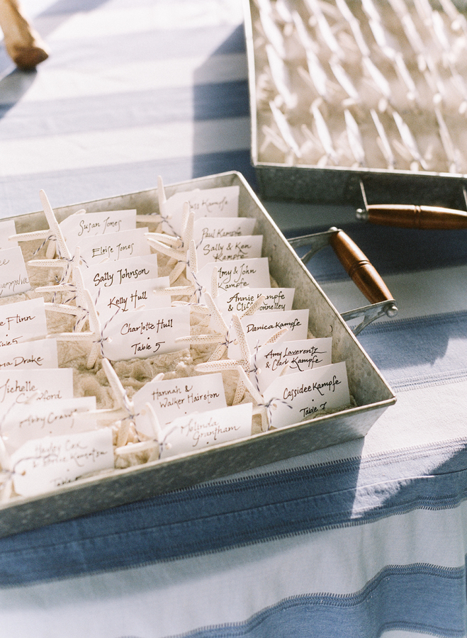 seashell-wedding-placecards http://itgirlweddings.com/white-party-rehearsal-dinner/