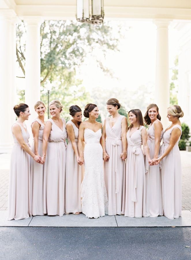 bride-bridesmaids-in-purple-long-dresses http://itgirlweddings.com/southern-white-tie-wedding/