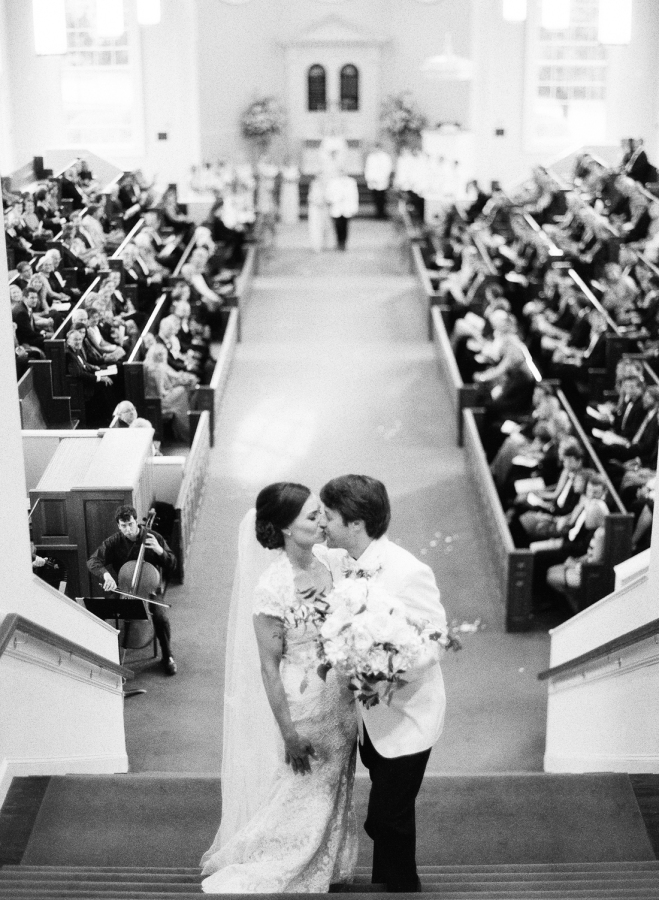 bride-groom-wedding-kiss-in-church-wedding http://itgirlweddings.com/southern-white-tie-wedding/