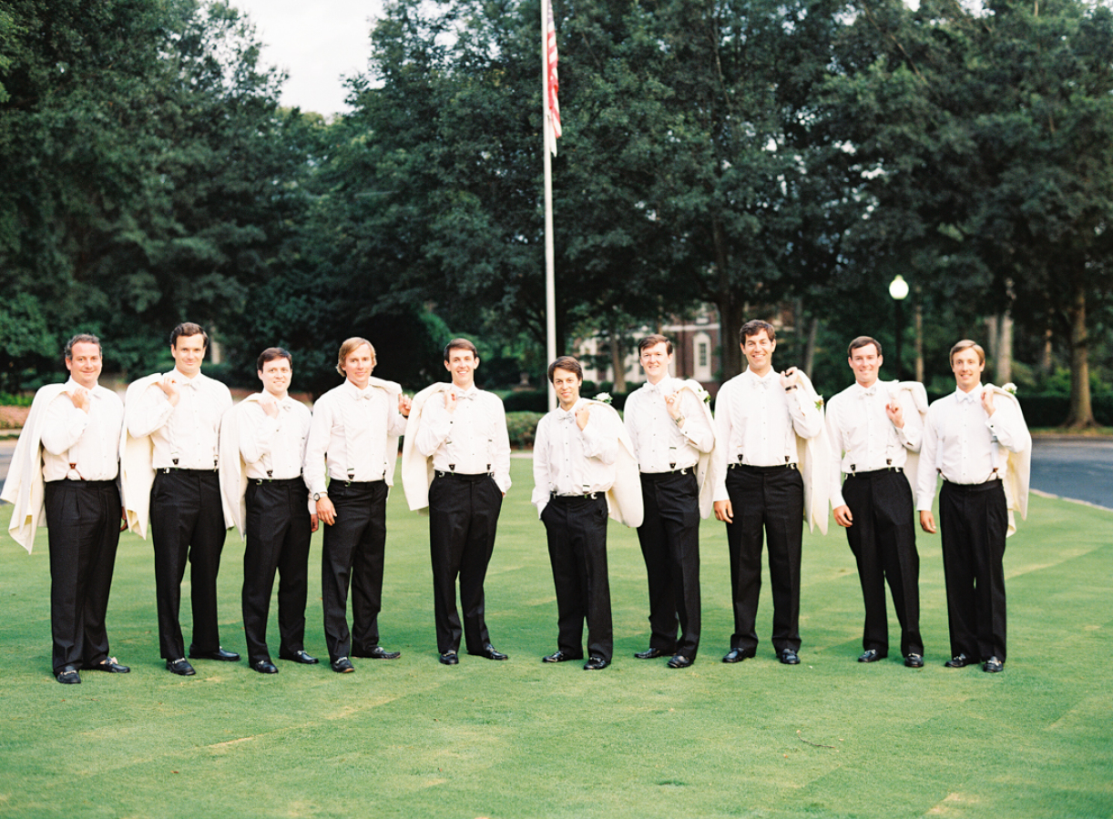 groomsmen-holding-jackets-white-jaclkets-black-pants http://itgirlweddings.com/southern-white-tie-wedding/