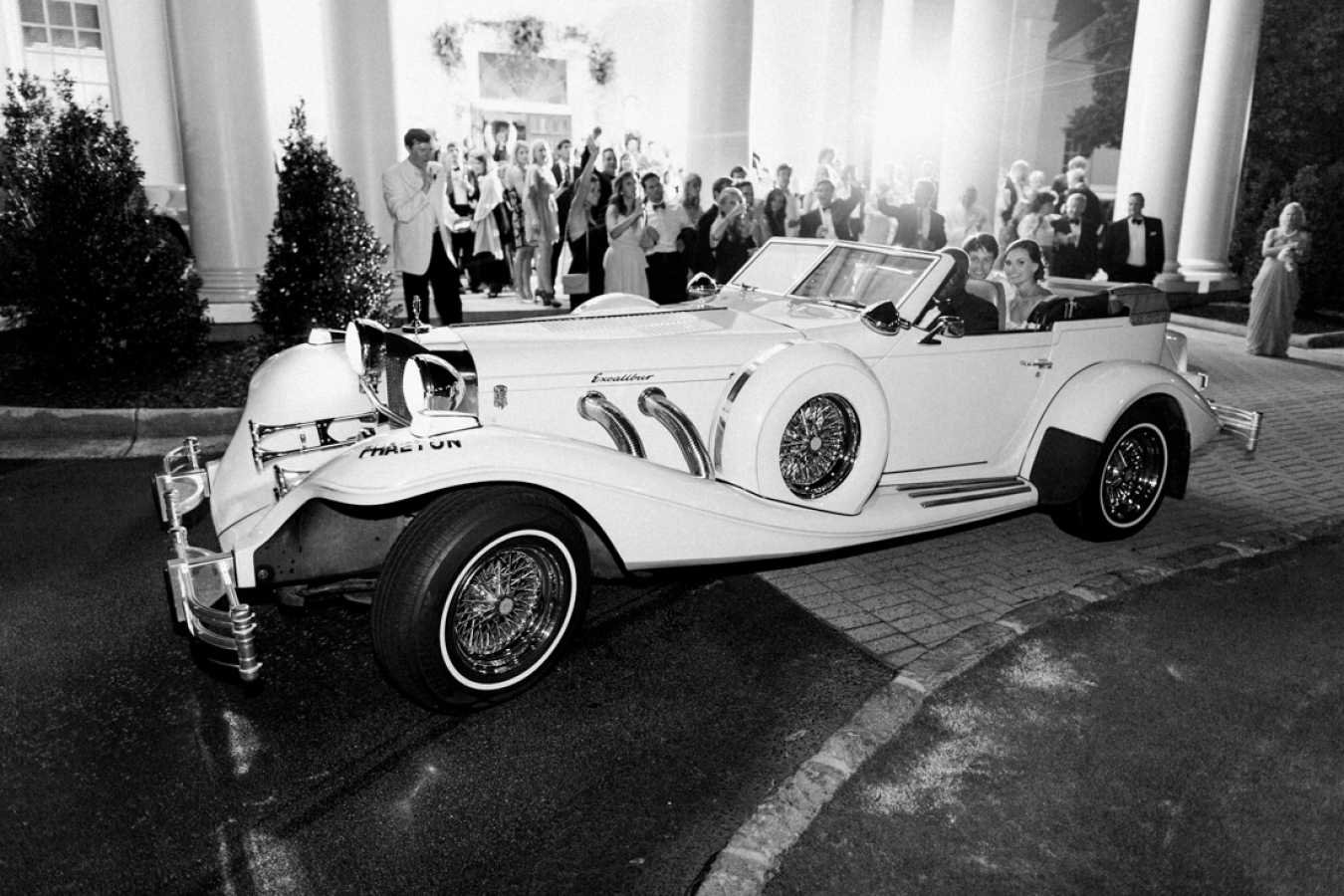 wedding-exit-in-white-vintage-car http://itgirlweddings.com/southern-white-tie-wedding/
