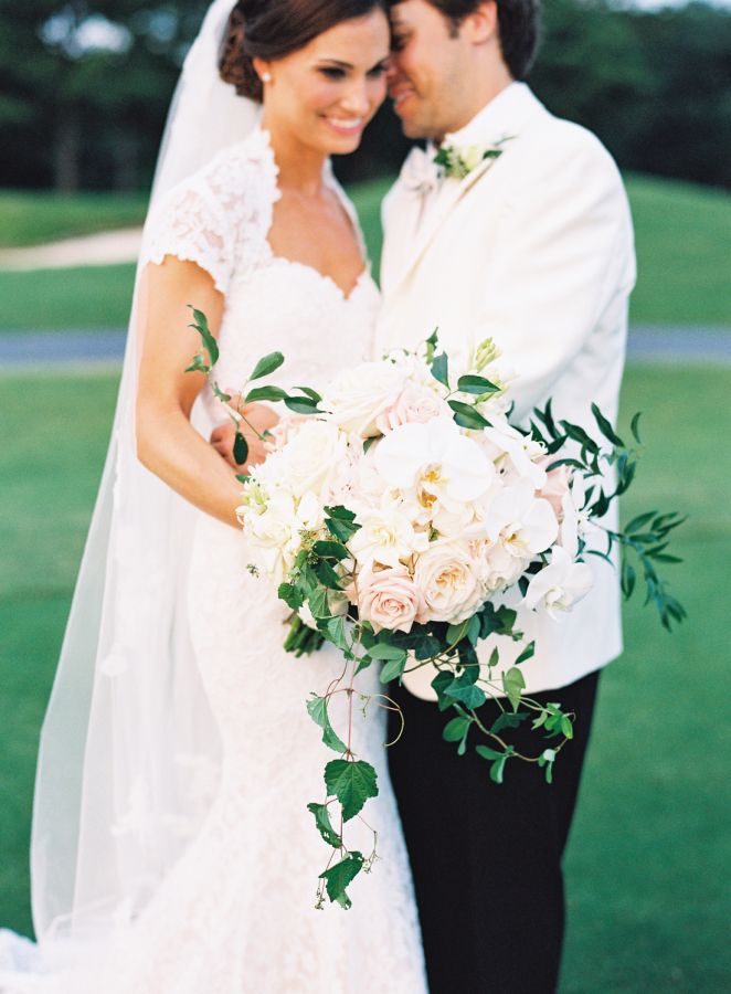 white-tie-groom-bride-lace-dress http://itgirlweddings.com/southern-white-tie-wedding/