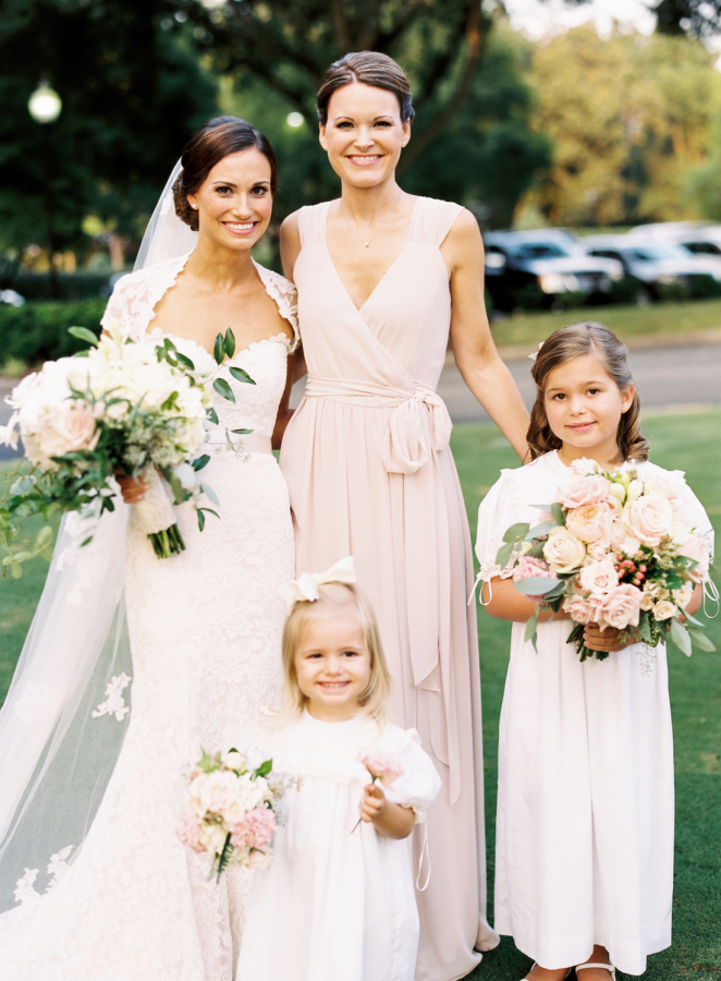bride-with-flower-girls-big-bouquets http://itgirlweddings.com/southern-white-tie-wedding/