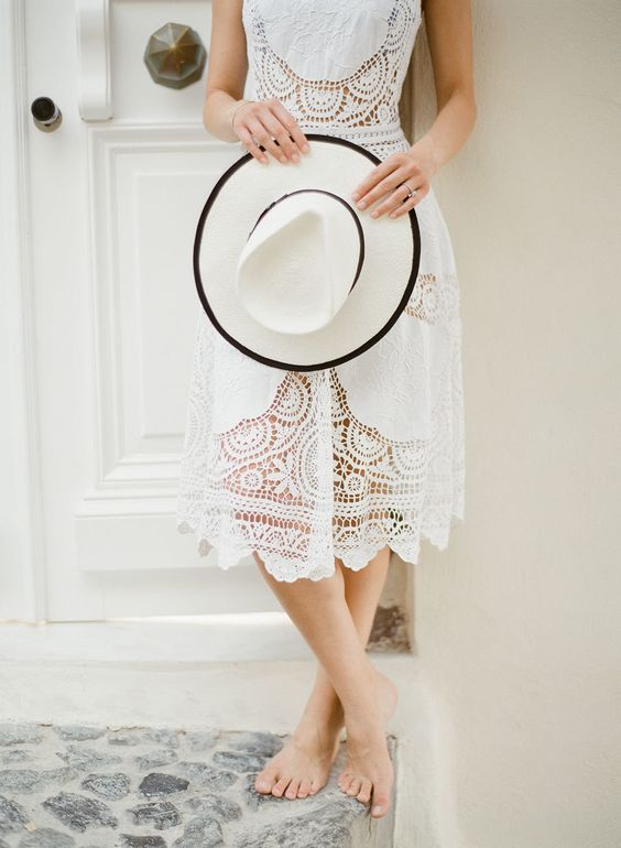 white-honeymoon-dress-sun-hat http://itgirlweddings.com/santorini-honeymoon-inspiration/