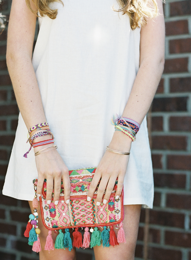colorful-tassel-clutch http://itgirlweddings.com/fiesta-themed-engagement-party/