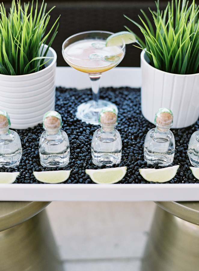lined-up-mini-patron-bottles-limes http://itgirlweddings.com/fiesta-themed-engagement-party/