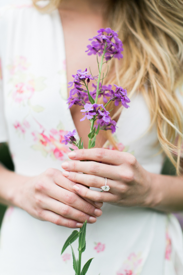girl-holding-purple-flowers http://itgirlweddings.com/nikki-ferrels-engagement-session/