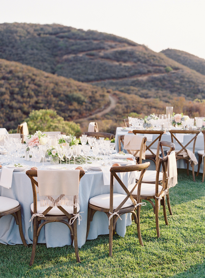 wedding-reception-blue-linens-low-wedding-flowers http://itgirlweddings.com/5-wedding-planning-tips/