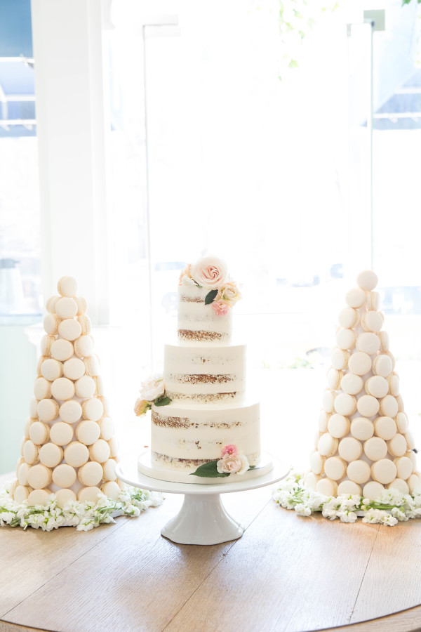 bridal-shower-cake-macaroon-tower http://itgirlweddings.com/tips-for-creating-a-photo-worthy-bridal-shower/