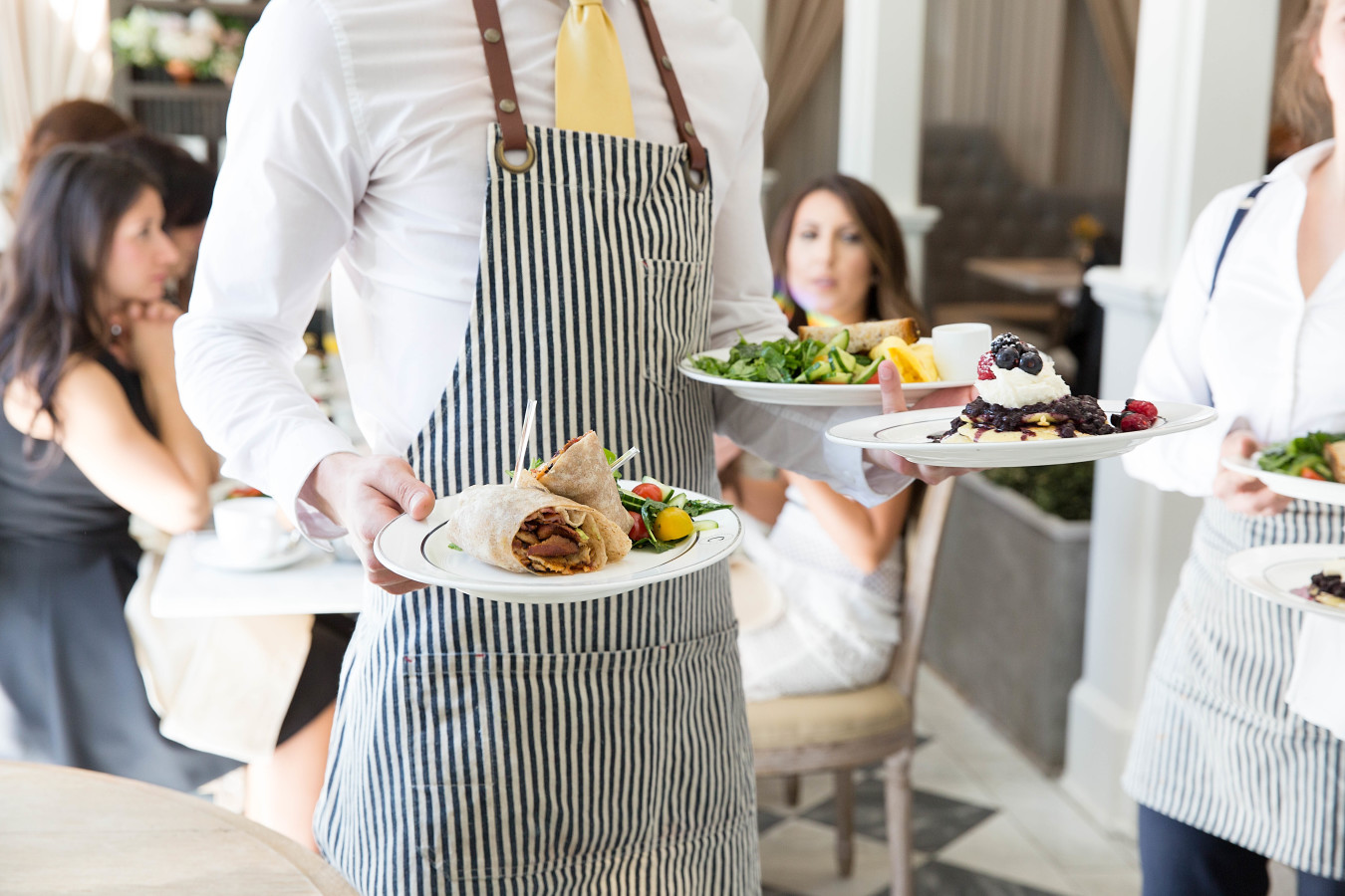 waiter-serving-bridal-brunch http://itgirlweddings.com/tips-for-creating-a-photo-worthy-bridal-shower/