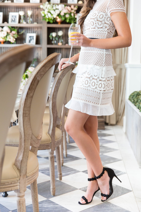 white-lace-short-bridal-shower-dress http://itgirlweddings.com/tips-for-creating-a-photo-worthy-bridal-shower/