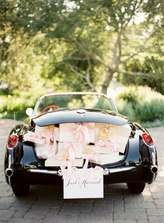 vintage car filled with wedding presents and just married sign