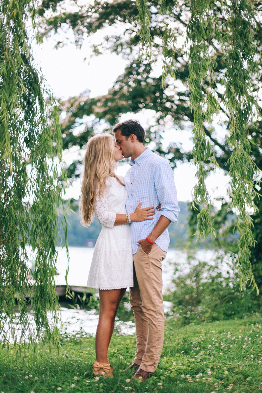 engagement-session-kiss-by-lake http://itgirlweddings.com/how-one-couple-nailed-their-engagement-session/