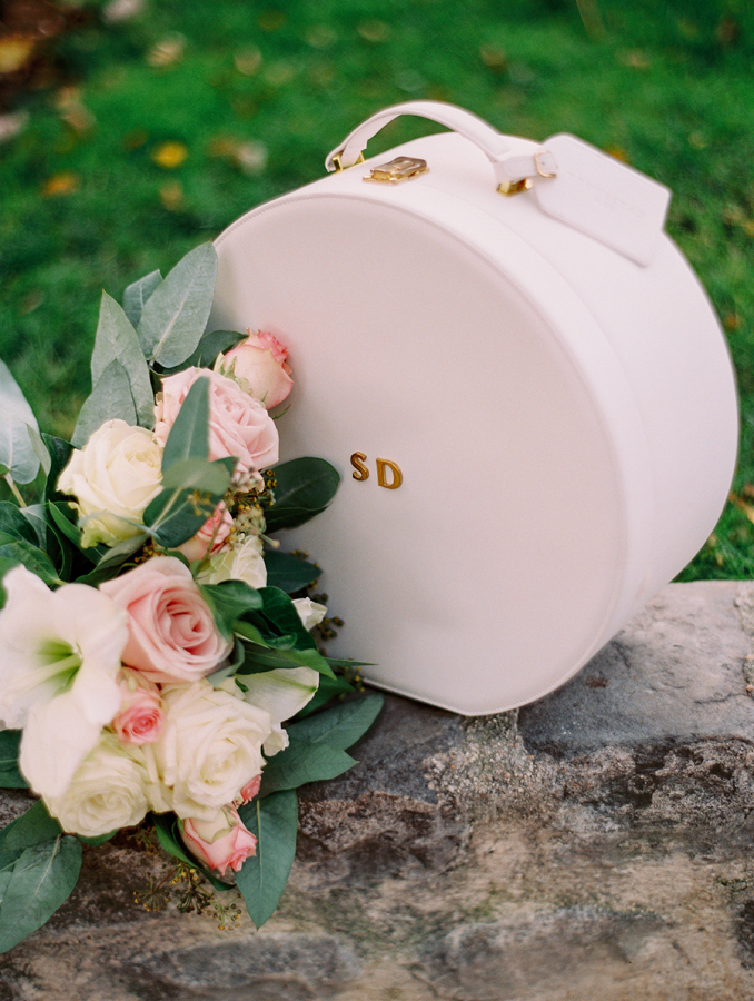 custom-white-hat-box-and-flowers http://itgirlweddings.com/parisian-wedding-inspiration/