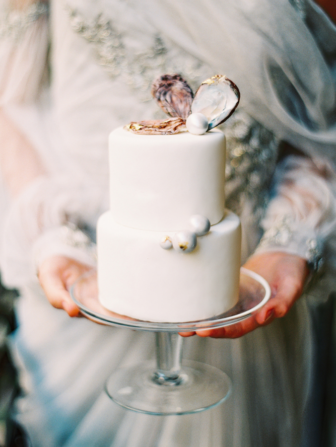 white-wedding-cake-with-pearl-shells-and-pearls http://itgirlweddings.com/parisian-wedding-inspiration/