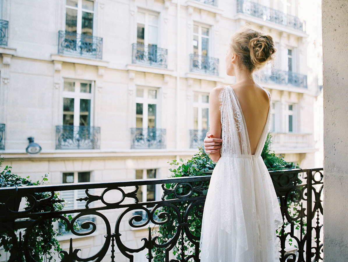 bride-on-paris-balcony-wearing-a-top-knot http://itgirlweddings.com/parisian-wedding-inspiration/