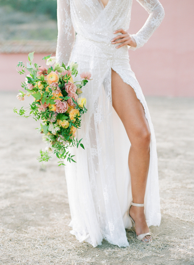 high-slit-wedding-dress-with-sleeves http://itgirlweddings.com/elopement-inspiration/