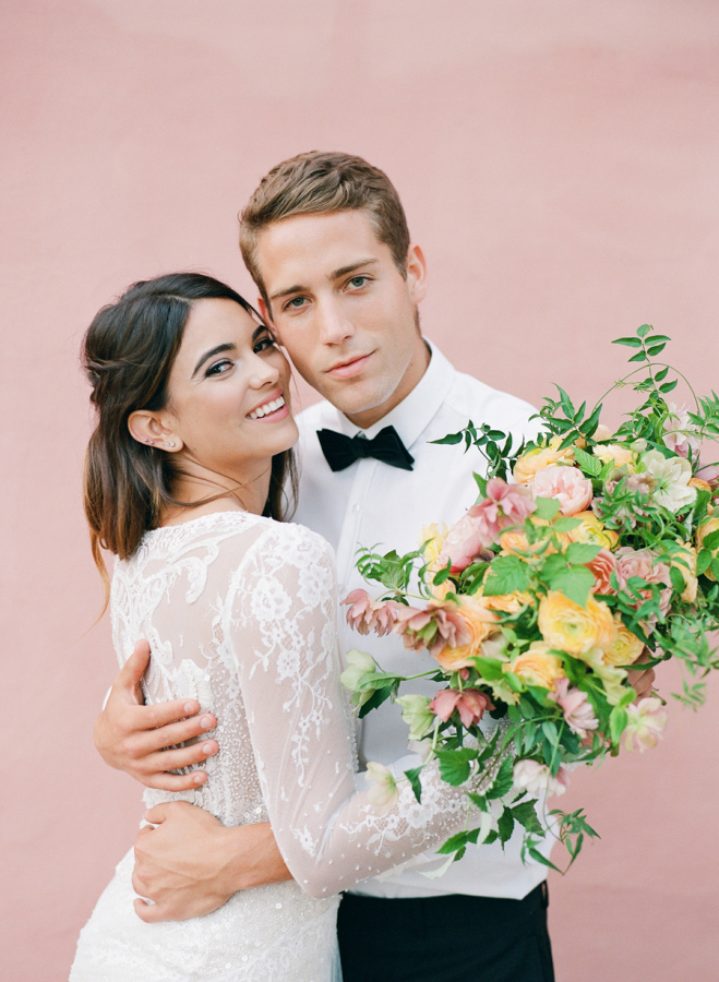 bride-and-groom-with-pick-backdrop http://itgirlweddings.com/elopement-inspiration/